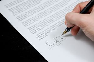 Images of legal documents being signed
